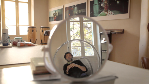 artificial dreams, man sat on swing reflected by mirror