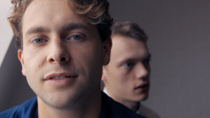 close up of two male members of a band