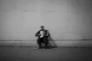 black and white shot of Accordion Player on streets of London, England